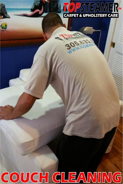 Top Steamer Technician Cleaning A Couch In Miami.